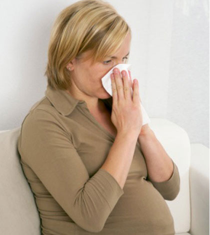 Насморк при беременности: симптомы